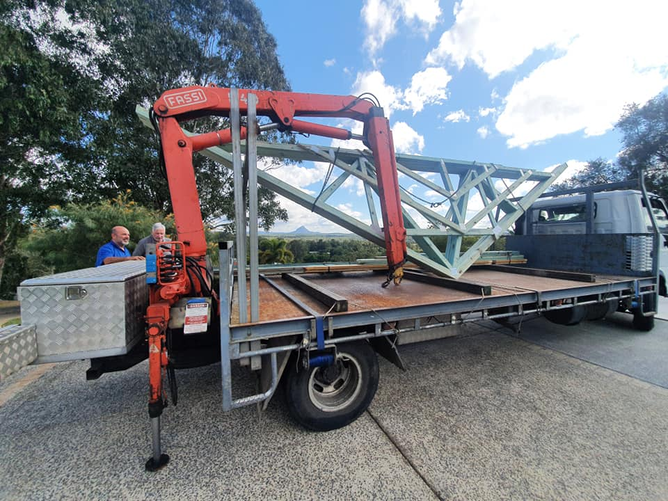 timber roof truss on back of truck