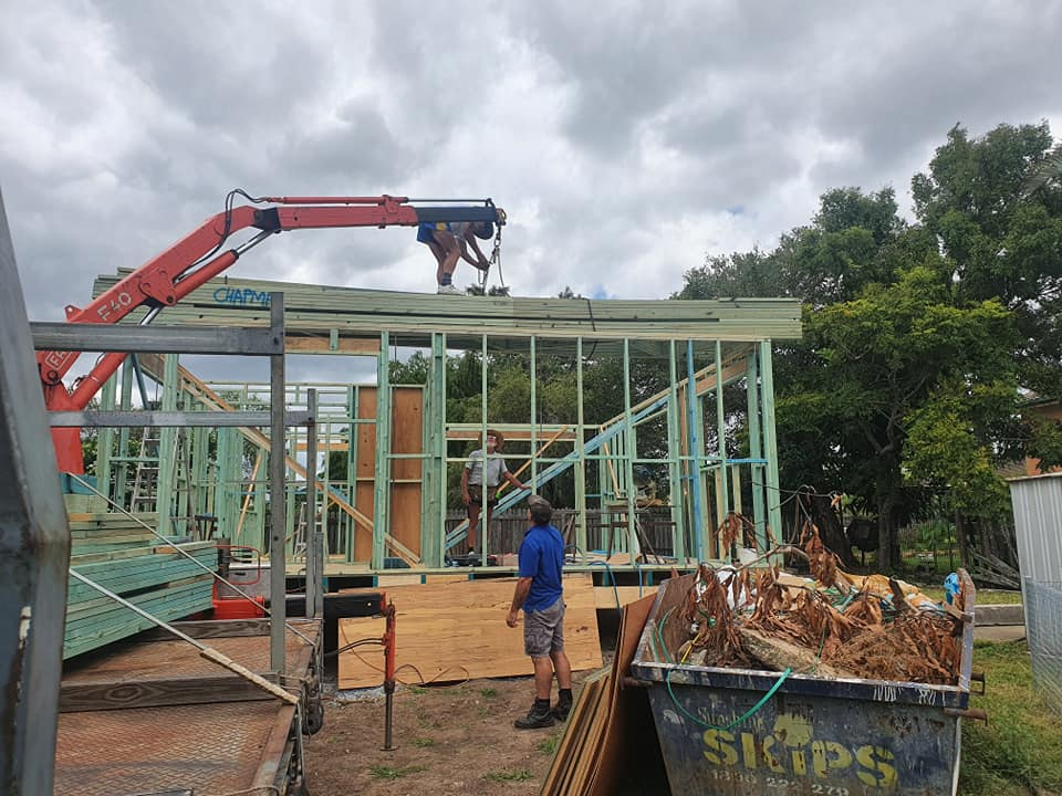 placing timber roof trusses on house frame