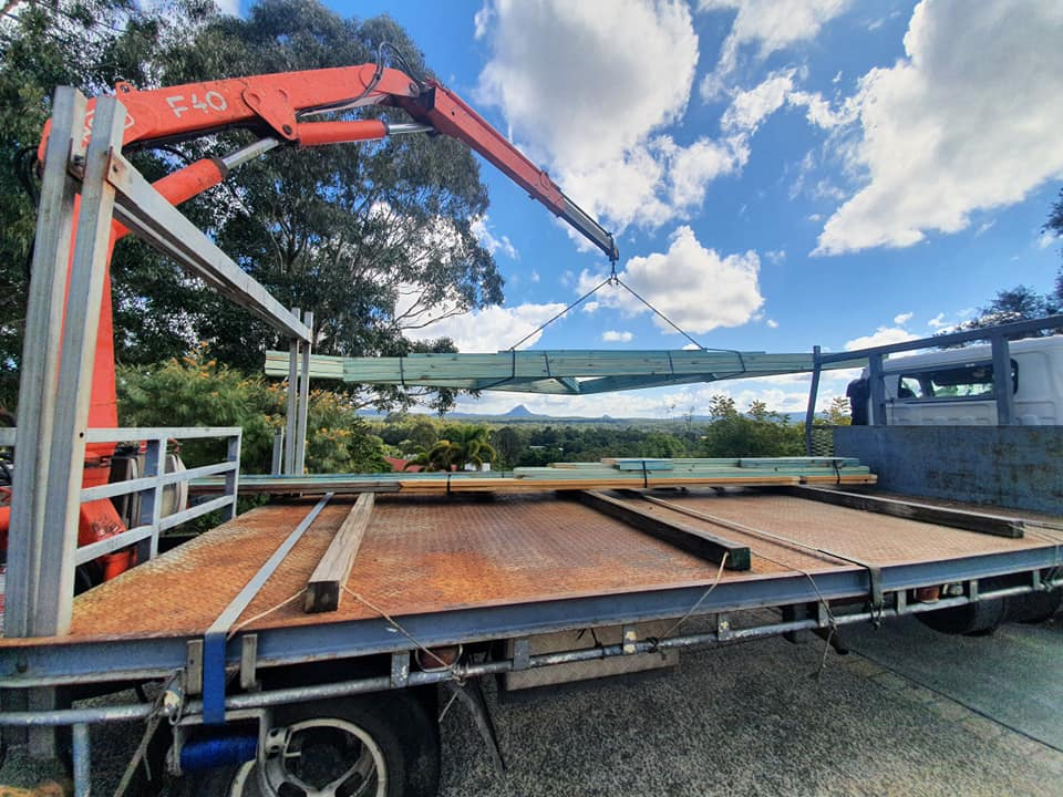 lifting timber roof truss off truck